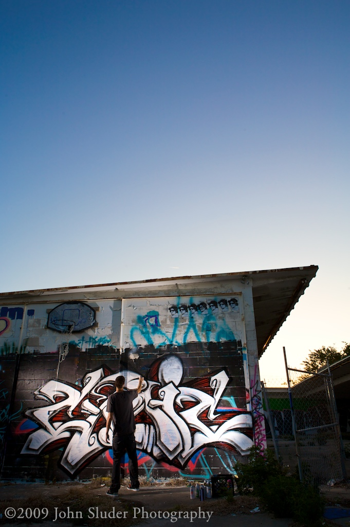 Cynic painting at dusk, John Sluder Photography